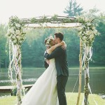 08-birch-wedding-arch-decorated-with-ribbon-and-lush-flowers